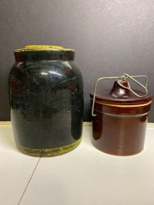BLACK STONEWARE CROCK WITH LID AND STORAGE CROCK WITH WIRE CLOSURE