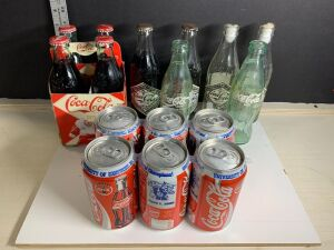 VARIETY OF COMMEMORATIVE COCA COLA BOTTLES AND CANS