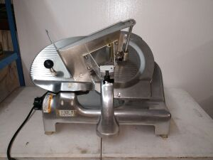 BERKEL BRAND ELECTRIC SLICER, TOP OF THE LINE NAME BRAND, JUST PULLED OUT OF SERVICE JUST PULLED OUT OF SERVICE, SELLER REPLACED WITH NEW ONE, DOES HAVE ALL PARTS TO INCLUDE BLADE SHIELD, BLADE SHARPENER, MODEL 909/1, 110 VOLT, HALF HORSEPOWER, COMES WITH