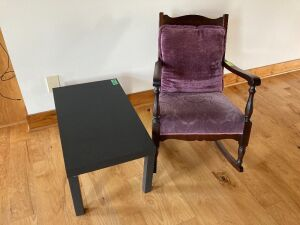 Purple upholstered arm rocker and small coffee table