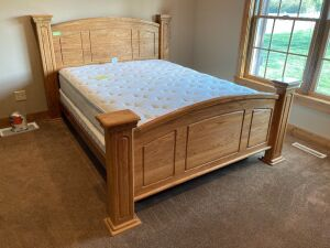 Heavy solid oak queen size box spring mattress headboard and footboard. Mattresses like new. It does have a split box spring 50 inches tall x 72 inches wide