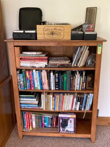 13x39x48-in bookcase (matches bookcase in lot 6554) AND contents including cassette tapes and CDs
