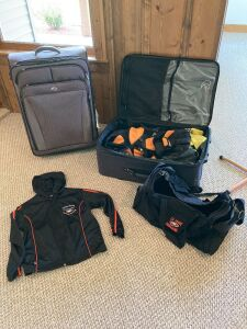 Two pieces of luggage, coat rack, Prairie HS Cedar Rapids buttons, cheerleading jackets, duffel bags and warm up jacket