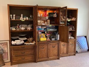 3-piece entertainment set 16x76x100. Will come apart into two independent bookcases, one with a drop front writing table. The center unit has a glass door hutch style top with slide out tray - NO CONTENTS - extremely HEAVY must bring help for moving