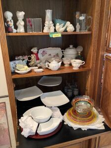 Various glassware and serving items including a white relish tray with dip bowl, three tier serving tray, cups, vases, praying children, several pieces of multi-colored ribbon depression glass bowls, saucers, pie plates and dinner plates