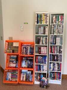 Over 200 VHS tapes, PLUS bookcase cabinets and modern milk crates