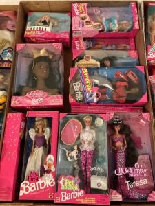 Approximately 14 Barbie dolls and Barbie related items - most with boxes but not new in the box