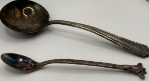 ONEIDA GRAVY LADLE AND REED AND BARTON GIRAFFE BABY SPOON. BOTH PIECES BELIEVE TO BE SILVER PLATE.