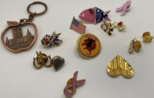 APPROXIMATELY 12 LAPEL PINS. INCLUDES A BIG APPLE KEYCHAIN.