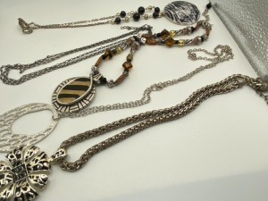 APPROXIMATELY FOUR FASHION ESTATE JEWELRY NECKLACES.
