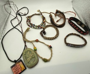 AND ASSORTMENT OF LEATHER AND BEADED BRACELETS AND MORE.