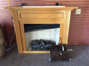 Fireplace insert with metal log holder