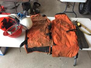 Lot of Cutting chaps and safety equipment.