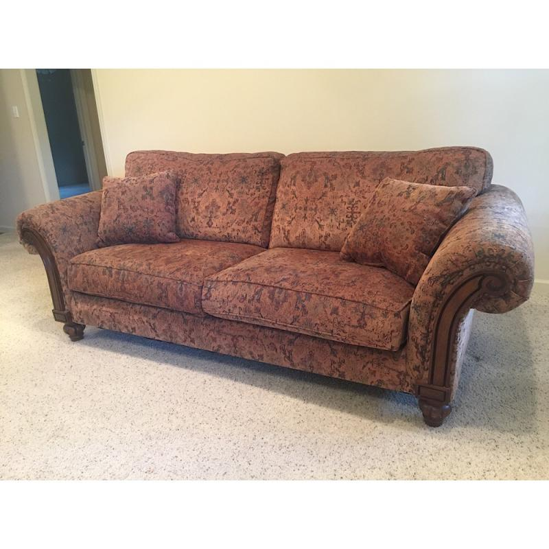 Sofa With Wooden Legs Arm Accents