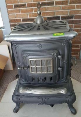 Cast iron gas stove - comes with three stories worth of chimney pipe - Hooked up to gas line!!